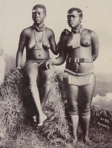 Two Zulu maidens (circa 1910), one with tribal marks on her stomach