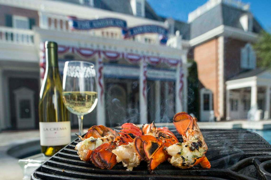 Griddled Lobster Tail with Garlic Herb Butter is paired perfectly with La Crema Sonoma Coast Chardonnay at the Hops & Barley Marketplace outside the American Adventure pavilion during the 18th Epcot International Food & Wine Festival Sept. 27-Nov. 11 at Walt Disney World Resort. (Matt Stroshane, photographer)