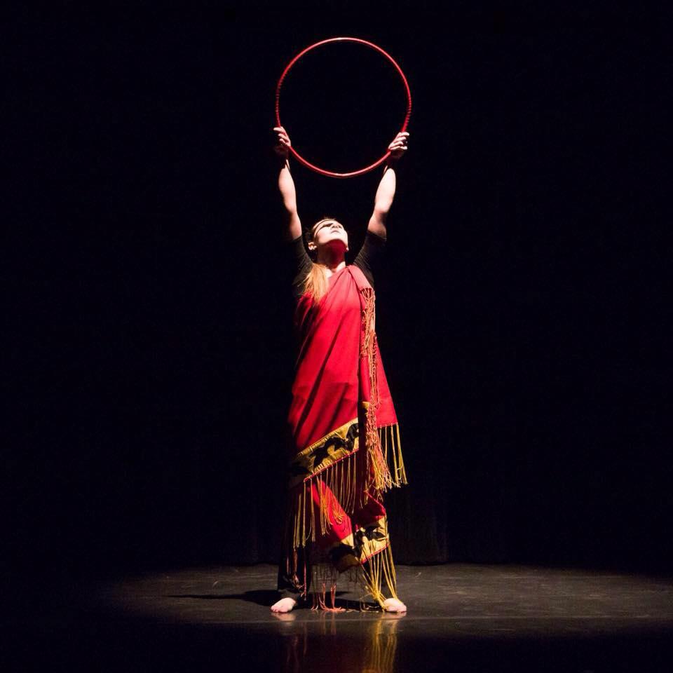 Emily Henderson performing a hoop dance.