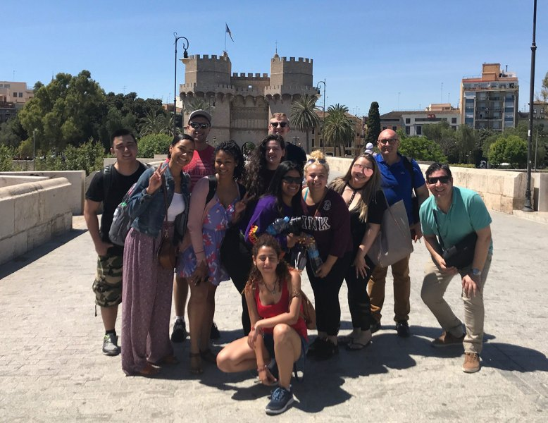 Faculty Led UMass Lowell Courses Abroad   Programs   International     group photo of UMass Lowell study abroad trip to Valencia  Spain
