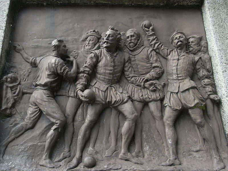 Sir Francis Drake whilst playing bowls on Plymouth Hoe is informed of the approach of the Spanish Armada. Bronze plaque by Joseph Boehm, 1883, base of Drake statue, Tavistock