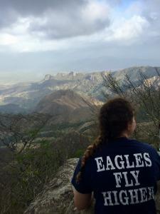 Ann Izzard enjoys the summit of a cloud-mountain peak in Panama.