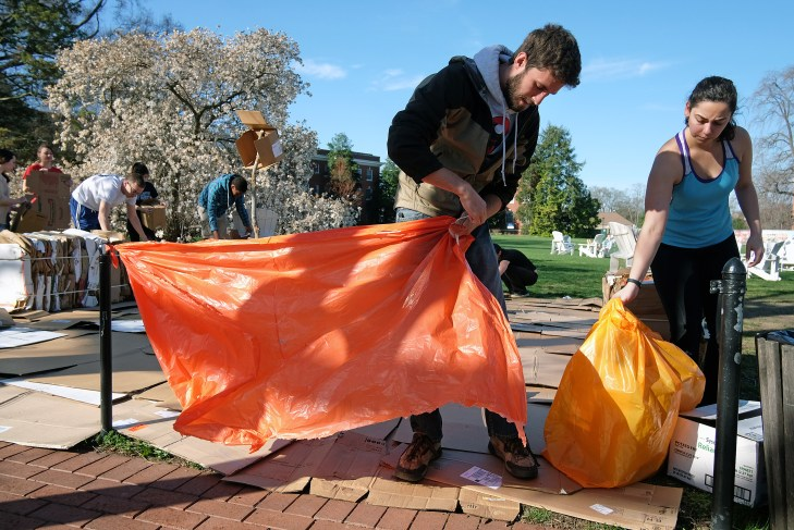 UMW students set up their shelter for the week long two dollar a day challenge, Monday, April 6, 2015. (Photo by Norm Shafer).