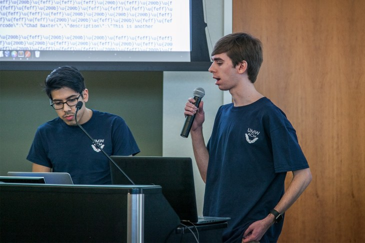 Diego Bustamante and Collin Mistr of Team Devils present at HackU 5. The team won the Best Solution to a Challenge category and took home tickets to the Revolution Conference in June.