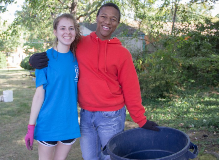 UMW students helped clear brush and spread mulch at St. Mar's Catholic Church in Fredericksburg. Photo by Christina Eggenberger.