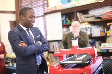 Mayor Stoney views student demonstration as Professor George Meadows looks on.
