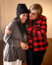 Anna Prezioso '09 reunites with UMW art professor Carole Garmon in duPont Gallery last week. Photo by Suzanne Rossi