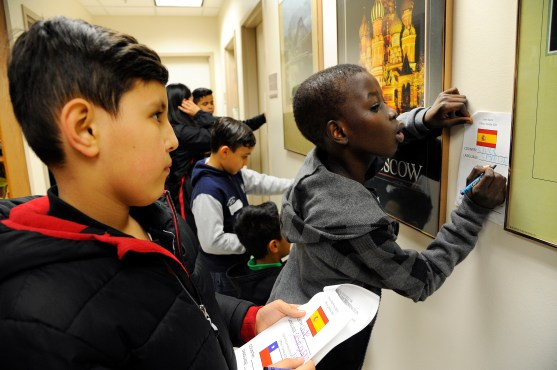 Local ESL students take part in a scavenger hunt in Combs Hall, where they had to find professors who also grew up speaking a language other than English. (Suzanne Rossi)