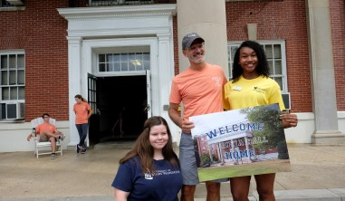 President Troy Paino helps incoming freshmen move in to their residence halls Wednesday morning.