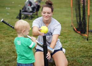 UMW student athletes share their sports, including softball, tennis, lacrosse and more, with area children each year during Eagle Nation Day. Photo by Suaznne Rossi.