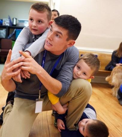 Crickman enjoys a light moment with Levi, Hunter and Carter Fishback.