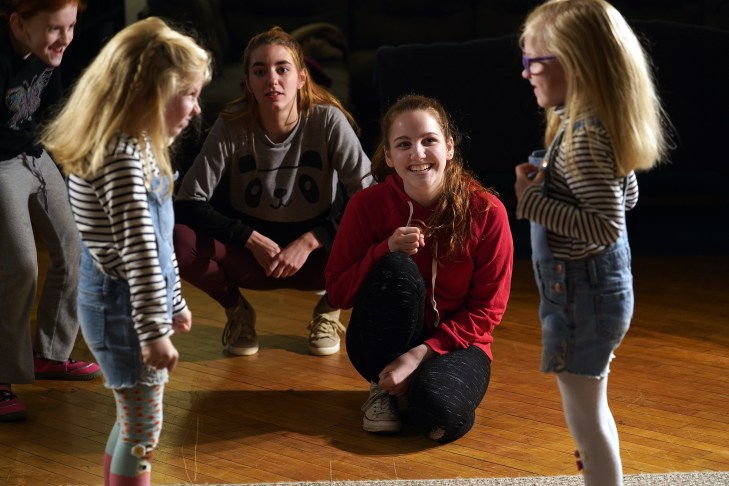 Fortune and Bloom watch while twin sisters try out some of their new acting skills at a recent Stage Door Youth Workshop. Photo by Suzanne Rossi.