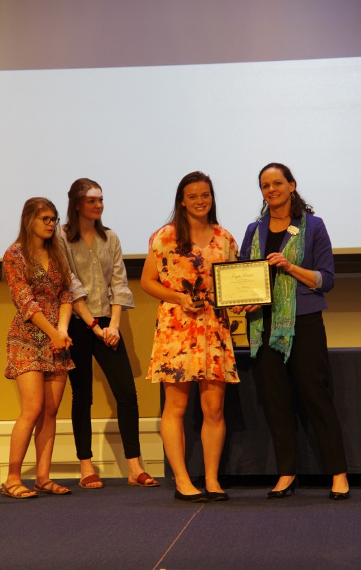 Graduating senior Paige Hildebrand won the Prince Woodard Outstanding Leader Award, presented by Juliette Landphair, vice president of Student Affairs. Photo by Noah Stroble.