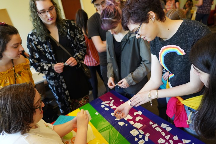 Grace Green (right) of UMW gets a temporary tattoo at the 29th Annual Multicultural Fair at UMW on Saturday. Photo by Suzanne Carr Rossi.