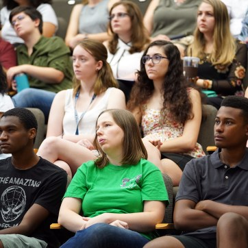 Onlookers packed the Hurley Convergence Center Digital Auditorium for the Summer Science Institute Research Symposium 2019. The program gives students a chance to plunge into research before the start of the school year. Photos by Suzanne Carr Rossi.