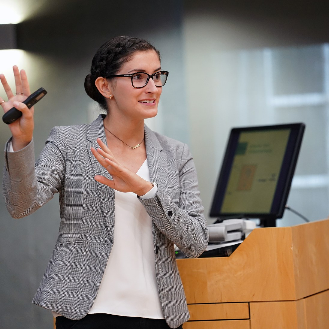 Summer Science Institute participant Kelly Flynn researched the effects of environmental stress on floral development. She presented her findings inside the packed Hurley Convergence Center Digital Auditorium. Photos by Suzanne Carr Rossi.