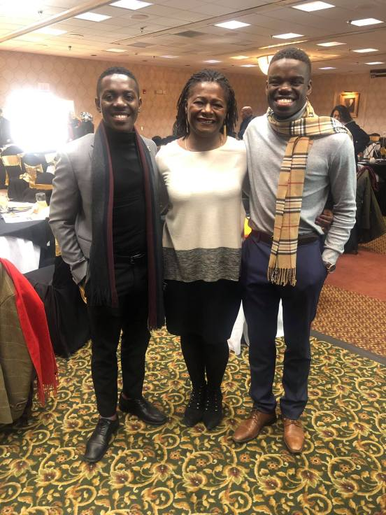Nehemia Abel (R) with his brother, Alexander Abel, a George Mason University alumnus, with Sabrina Johnson, UMW's vice president for equity and access and chief diversity officer. Aided by StartUpUMW, the brothers founded their own nonprofit, UBUMWE, which helps local Burundian youth.