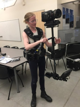 After receiving a bachelor's degree from UMW, Kyler went on to earn a master's in photographic and electronic media at the Maryland Institute College of Art. She is shown here in graduate school, flying a Steadicam.