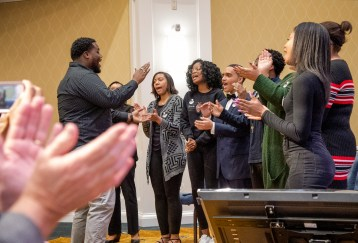 UMW's Voices of Praise sang Stevie Wonder's spirited version of 'Happy Birthday' for Dr. Farmer, while the audience clapped. Photo by Tom Rothenberg.