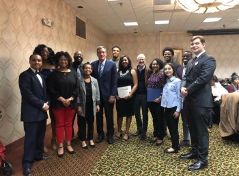 Members of UMW's NAACP chapter pose with Sen. Mark Warner at the Fredericksburg NAACP Branch MLK Breakfast. Photo by Karen Pearlman.