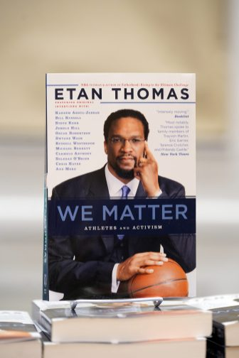 Thomas signed copies of his 2018 book, 'We Matter: Athletes and Activism' after the keynote. Named one of Book Authority's best activism books of all time and tied for best non-fiction at the 2018 African-American Literary Awards, 'We Matter' features Thomas' interviews with the families of Trayvon Martin, Eric Garner, Terence Crutcher and Philando Castile, as well as team CEOs, sportscasters, media personalities and athlete-activists like Kareem Abdul-Jabbar, John Carlos, Laila Ali, Carmelo Anthony and Dwyane Wade. Photo by Suzanne Carr Rossi.