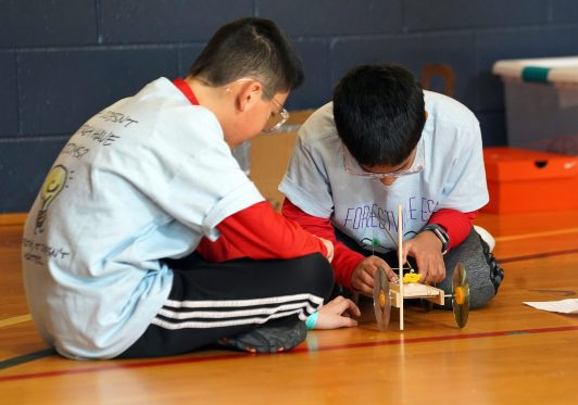 Alexander Fang, 11, (left) and Sidh Jaddu, 11, (right), fifth-graders at Forestville Elementary School in Great Falls, comptete in the Mousetrap Vehicle competition. Science-related contests were held in UMW's recently renovated Jepson Science Center and in other areas on campus. Photos by Suzanne Carr Rossi.