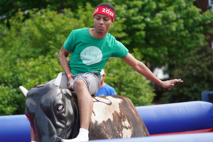 A mechanical bull-riding competition has become part of traditional Devil Goat Day events. This year, the uniquely UMW tradition is taking place virtually. Photo by Suzanne Carr Rossi.