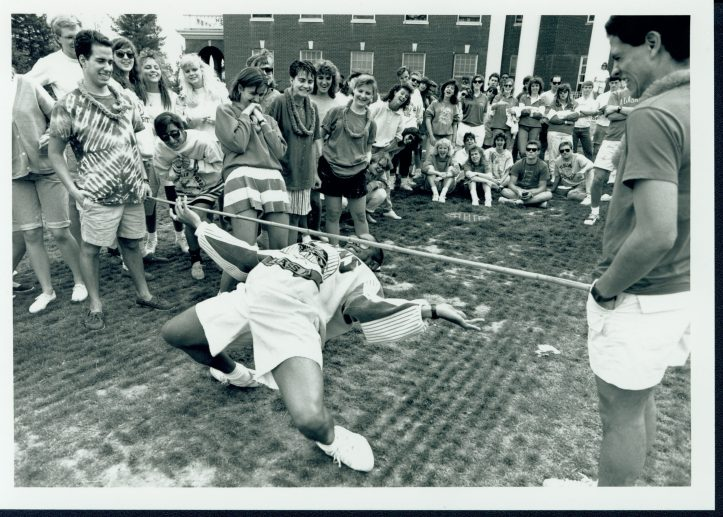 Students compete in a limbo contest on Devil Goat Day in 1989. Photo courtesy of Simpson Library Special Collections.