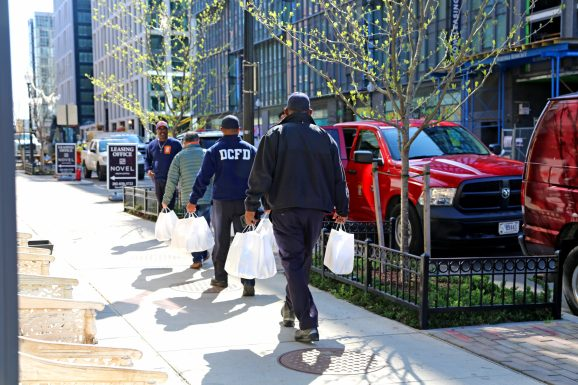 D.C. firefighters picking up Power of 10 meals from Bruner-Yang's restaurant, ABC Pony. Photo Credit: Foreign National.