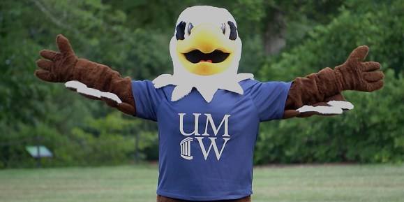 UMW mascot Sammy D. Eagle uses his 6-foot wingspan to illustrate one of the most important social distancing guidelines that will be in effect when the campus community returns in August.
