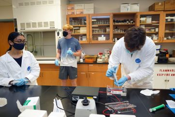 From left to right: First-year students Arianna Chase, Andrew Cooper and Mitchell Freitag conduct an experiment in a lab in the Jepson Science Center. Photo by Suzanne Carr Rossi.