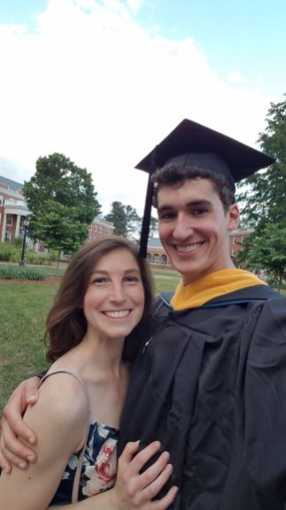 Caroline Deale attends John Bentley's graduation ceremony for the master's degree he earned in geospatial analysis at UMW in 2019.