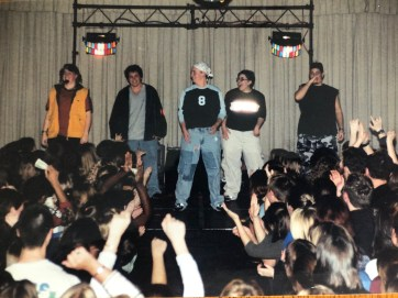 """At Mary Washington's first-ever drag show, a group of female students performed as Out of Sync, a take on late '90s boy band 'N Sync. From left to right, Jennifer """"Jiff"""" Fortner '02, Virginia Bach '02, Carrie Hardin '01, Robin Farmer and Lanie Pepitone. Photo courtesy of Mark Thaden."""