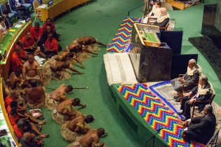 """Fijians perform the Kava Ceremony, also known as Na Yaqona Vakaturaga at the opening of The Ocean Conference Opening Ceremony in the GA Hall on June 05, 2017. Seated on the dais from left to right, Deputy Prime Minister of Sweden H.E. Isabella Lövin, Peter Thomson, President of the 71st session of the General Assembly, Prime Minister of the Republic of Fiji H.E. Frank Bainimarama, and Secretary-General of the United Nations H.E. António Guterres. Seated next to H.E. and Secretary-General of the United Nations H.E. António Guterres is his """"Herald Man"""" who is a traditional part of the ceremony"""