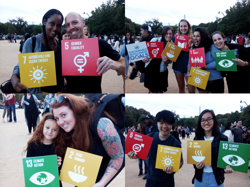 People at the Global Citizen Concert show their support for the Sustainable Development Goals.