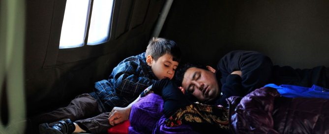 Photo: In Croatia, a refugee family rests in the UNICEF-supported Family Area at the reception centre in Opatovac.