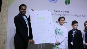 Photo: UN Youth Envoy Ahmad Alhendawi and UNFCCC chief Christiana Figueres speak at Youth Day at #COP21 in Paris.