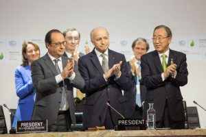 Photo: UN Secretary-General Ban Ki-moon (right), French Foreign Minister and COP21 President, Laurent Fabius (centre), and French President Franois Hollande (left) at the UN climate change conference in Paris. 12 December 2015.