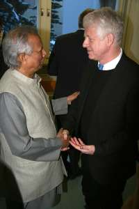 Photo: Advocates Muhammad Yunus and Richard Curtis have a discussion in Davos.
