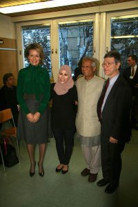 Photo: SDG Advocates Queen Mathilde of Belgium, Alaa Murabit, Muhammad Yunus and Jeffrey Sachs pose for a photo in Davos.