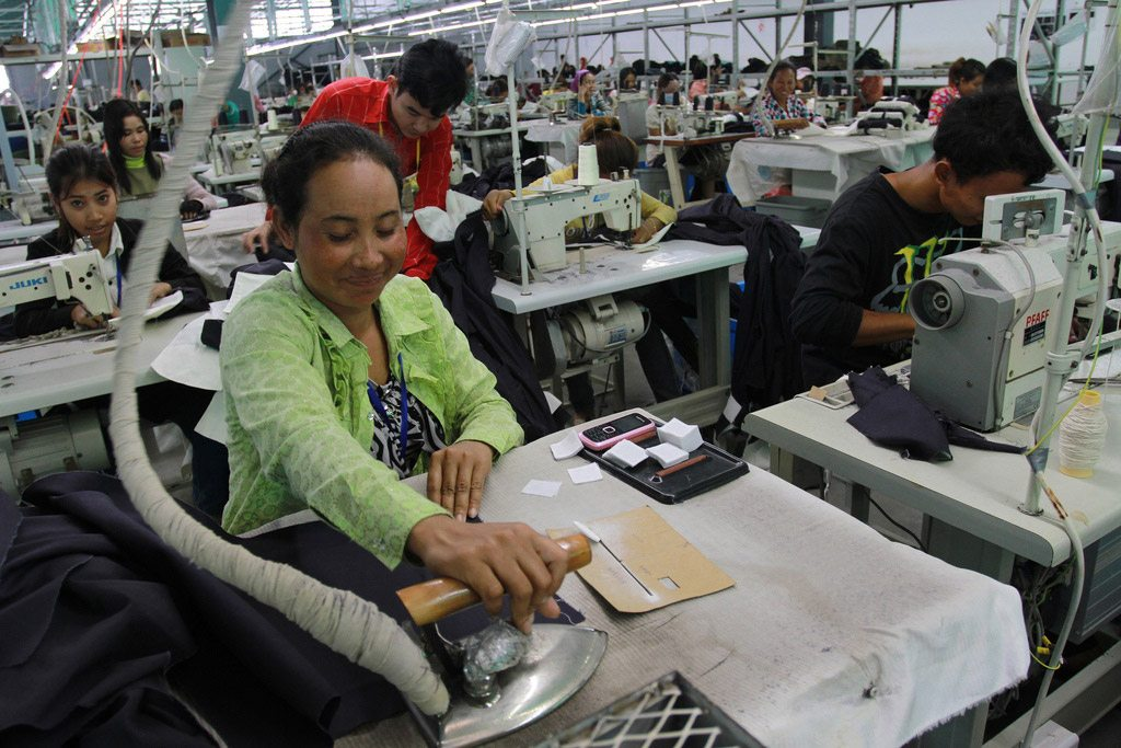 Photo: A woman irons fabric at a garments factory at the Sihanoukville Special Economic Zone, Phnom Penh, Cambodia. Photo: World Bank/Chhor Sokunthea