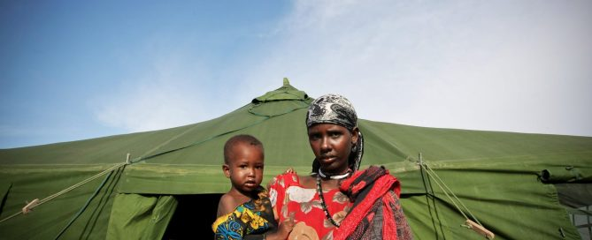 Photo: A Somali woman and a malnourished child exit from the medical tent after the child receives emergency medical treatment from the African Union Mission in Somalia (AMISOM), an active regional peacekeeping mission operated by the African Union with the approval of the United Nations. Somalia is the country worst affected by a severe drought that has ravaged large swaths of the Horn of Africa, leaving an estimated 11 million people in need of humanitarian assistance. UN Photo/Stuart Price.