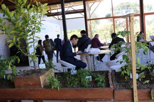 Photo: Habitat 3 participants work in the One UN Pavilion.