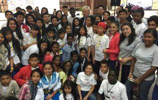 Photo: Joan Clos meets with kid attendees at Habitat 3.