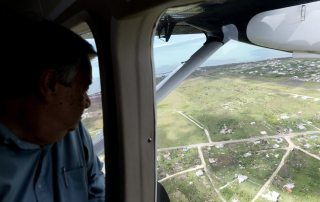 Photo: Secretary-General António Guterres surveys the damage from Hurricane Irma in Barbuda on 7 October.