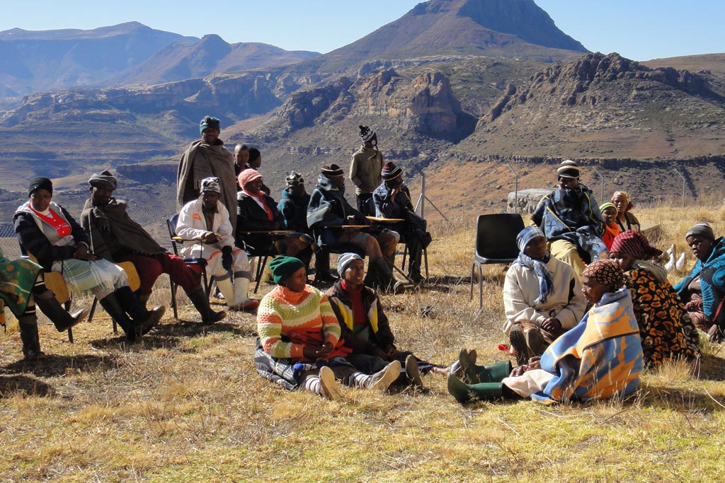 Photo: Women and men members from a local community in Lesotho participate in consultations to develop district plans to address climate change impacts and food insecurity.