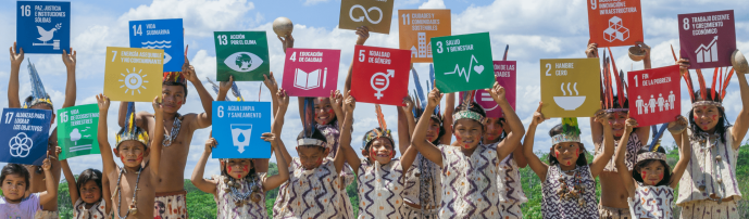 presentation image of children holding signs of each of the 17 development goals