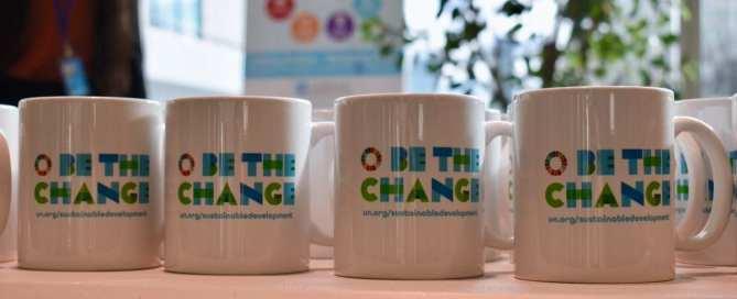"""Be the Change""-branded mug"