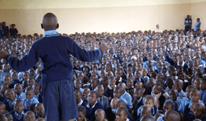More than 700 children packed into the auditorium at the KinyanjuiRoadPrimary School in Kawangware, Kenya, to watch, and take part, in an interactive series of plays addressing domestic violence. Photo credit: UN Women/Felix Eldridge