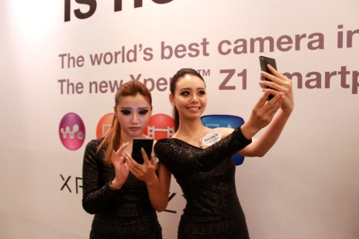 Models playing around with the Xperia Z1 during the regional launch